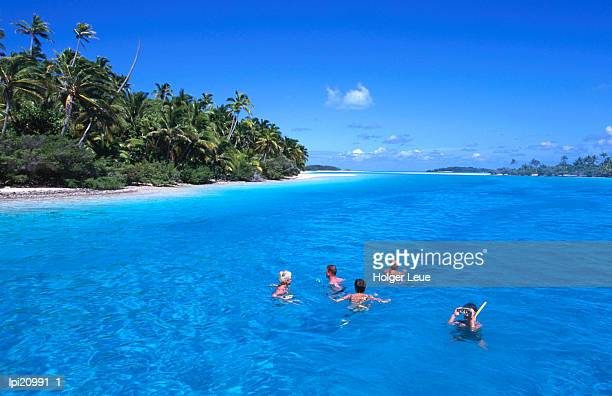 snorkelling at one foot island, aitutaki lagoon, cook islands - travel14 stock pictures, royalty-free photos & images