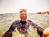 Snorkelling selfie of a senior man