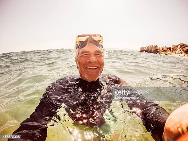 Snorkelling selfie of a senior man