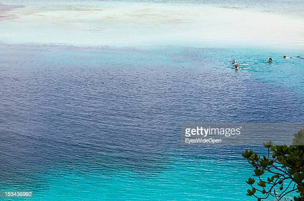 Snorklers swimming over Dean´s Blue Hole that is with a depth of 202 meters the deepest blue hole in the world and famous with freedivers on June 15,...