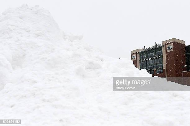 Snow accumulates in the parking lot prior to a game between the Green Bay Packers and the Seattle Seahawks at Lambeau Field on December 11 2016 in...