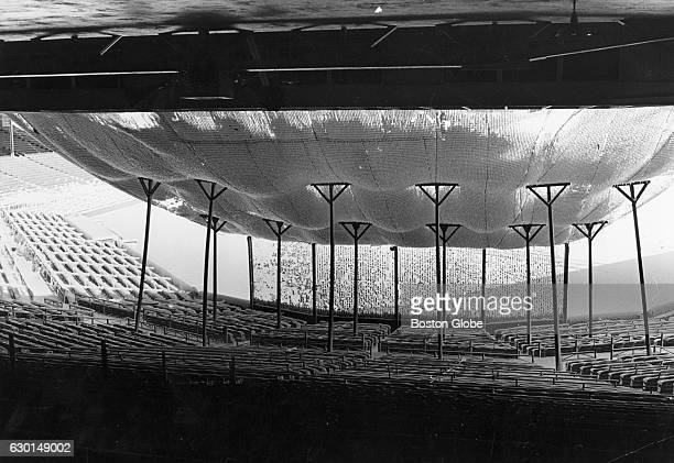 Snow accumulates on the net over the seats behind home plate at Fenway Park in Boston on Feb 11 1969
