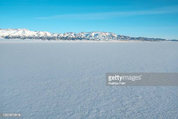snow and distant snow mountain - snowfield stock pictures, royalty-free photos & images