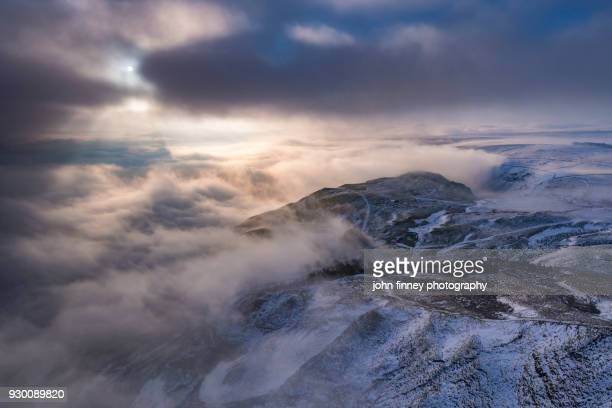 Snow and fog cover the English Peak District. UK.