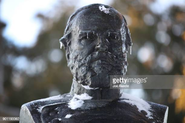 Snow and ice are seen on a statue as snow that fell yesterday and cold weather blanket the area on January 4 2018 in Savannah Georgia From Maine to...