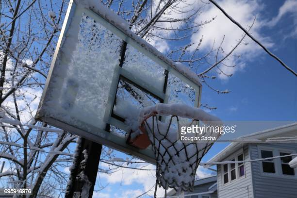 snow and ice coverd basketball hoop - winter sports event stock pictures, royalty-free photos & images