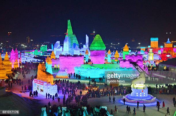 Snow and ice sculptures and structures are illuminated at the annual snow and ice festival in Harbin the capital of China's northeastern Heilongjiang...