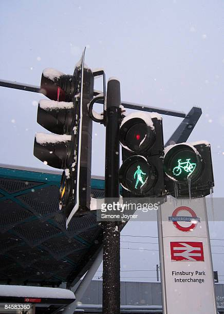 Snow and icicles cover a traffic light outside Finsbury Park station on February 2 2009 in London United Kingdom The United Kingdom has suffered its...