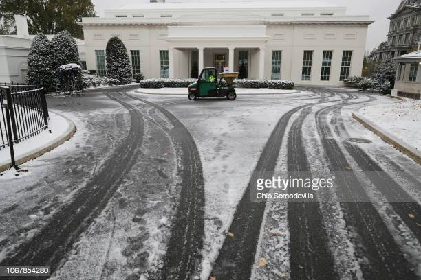 Snow and sleet from Winter Storm Avery covers the ground at the White House November 15 2018 in Washington DC After moving through the Midwest the...