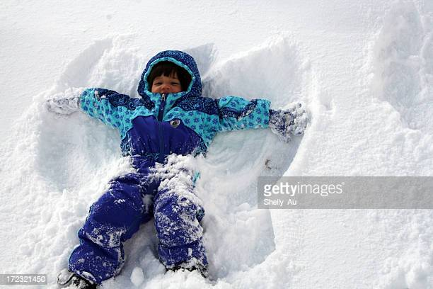 snow angel fun - snow angel stock photos and pictures