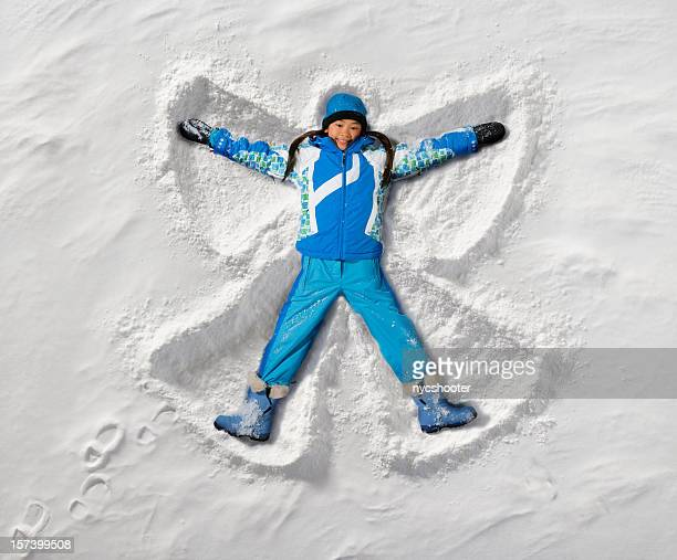 snow angel - snow angel stock photos and pictures