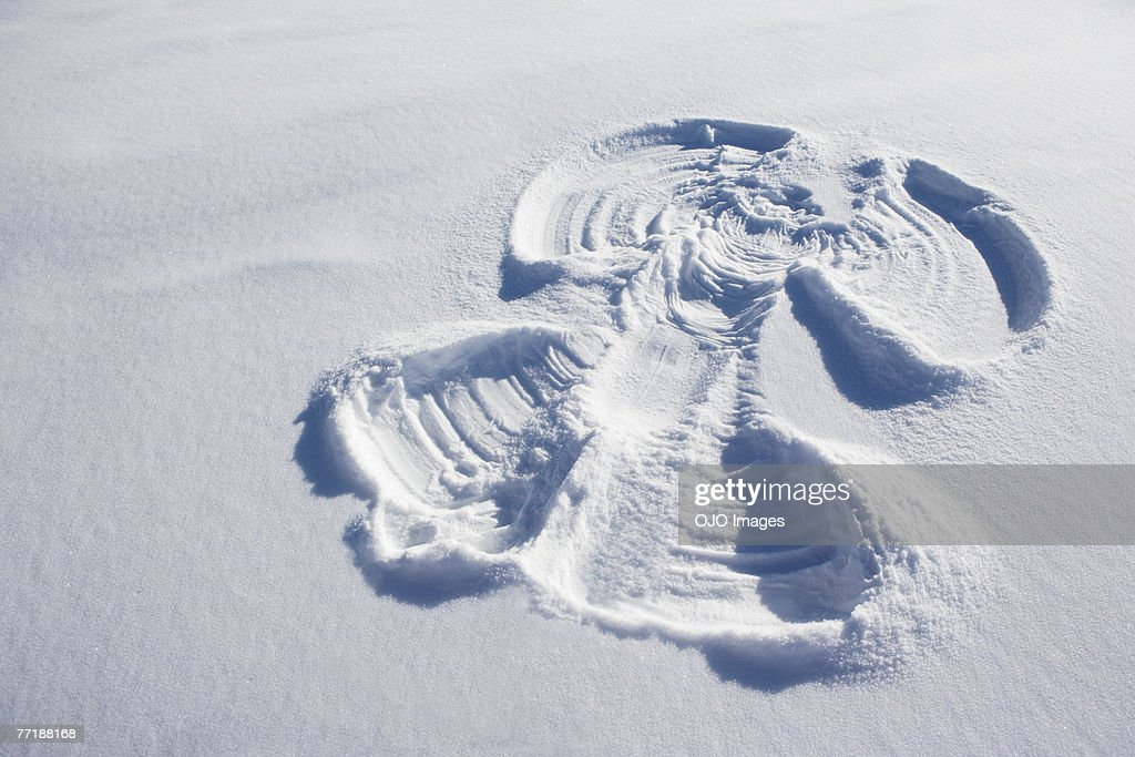 A snow angel : Stock Photo