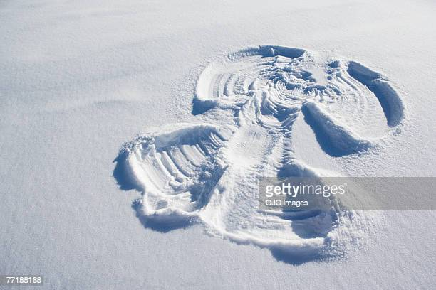 a snow angel - snow angel stock photos and pictures