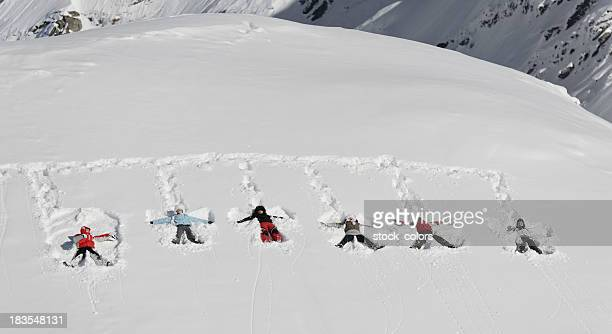 snow angels - snow angel stock photos and pictures