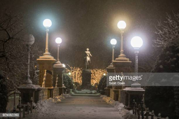 Snow begins to accumulate in the Boston Public Garden as another major nor'easter barrels Into northeastern US on March 8 2018 in Boston United States