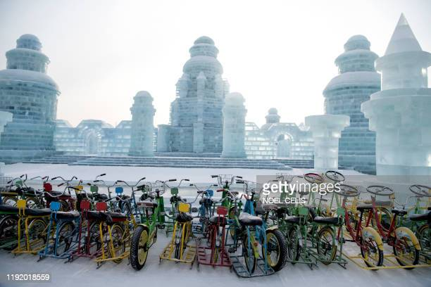 Snow bicycles are parked at the Harbin International Ice and Snow Festival in Harbin in China's northeast Heilongjiang province on January 6 2020...