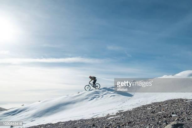 snow biking - mountain bike stock pictures, royalty-free photos & images