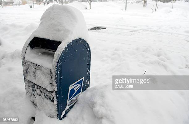 Snow blankets a USPS mailbox during a snow storm in Washington DC February 6 2010 A huge blizzard dumped a blanket of thick snow over the US east...
