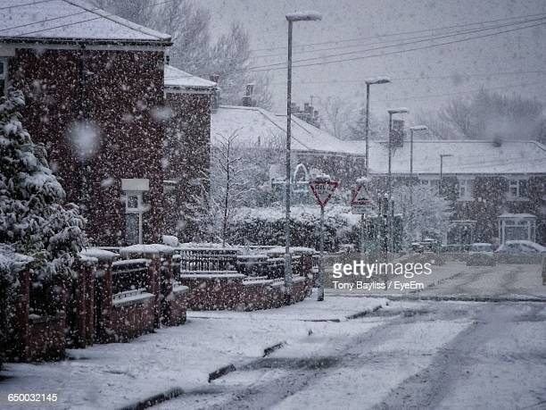 snow blizzard in residential district - manchester uk stock photos and pictures