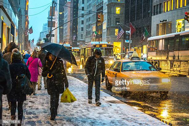 Snow blizzard, Traffic and people on 5th Avenue, NYC