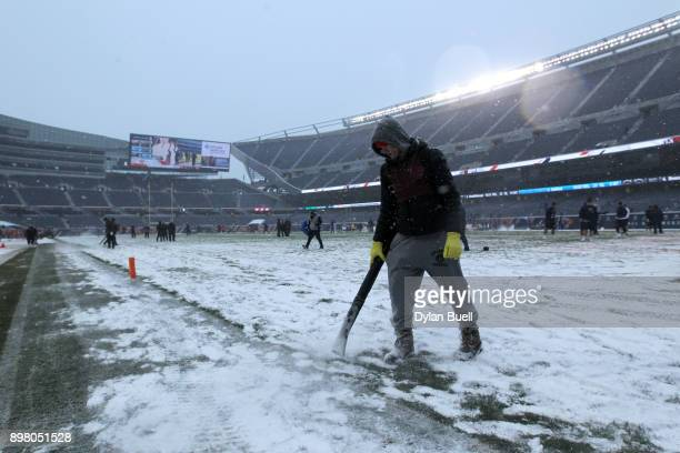 A snow blower is used prior to the game between the Chicago Bears and the Cleveland Browns at Soldier Field on December 24 2017 in Chicago Illinois