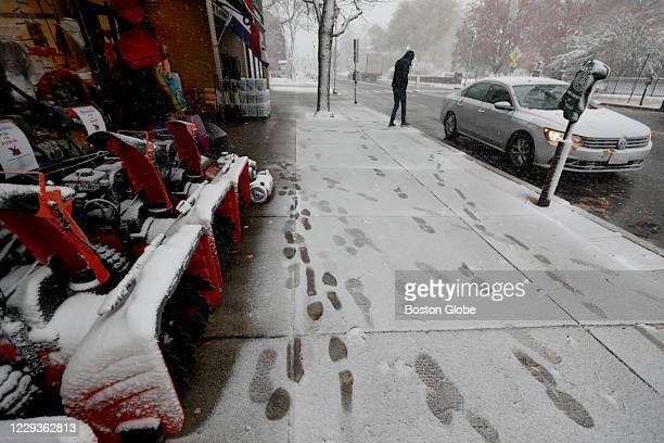 Snow blowers for sale in a snowy scene Green's Hardware in Wellesley, MA on Oct. 30, 2020.
