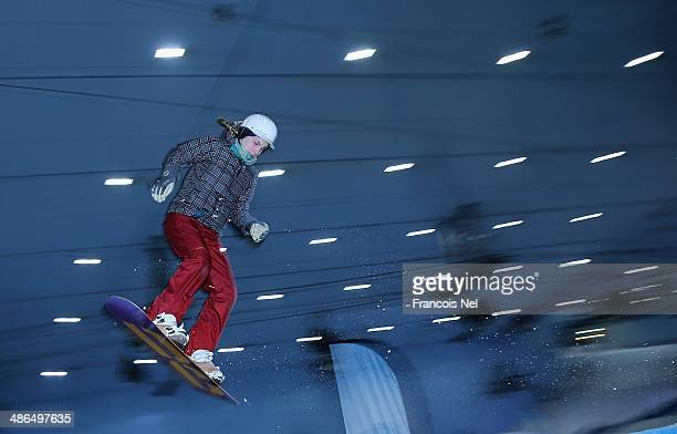 A snow boarder takes part in a special themed 'Freestyle Night Goes Mutant' event to promote 'X Men Days Of Future Past' at Ski Dubai on April 24...