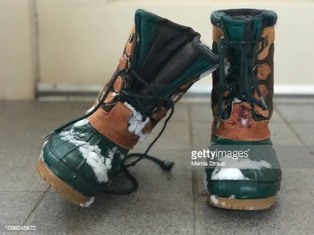 snow boots - snow boot stock photos and pictures