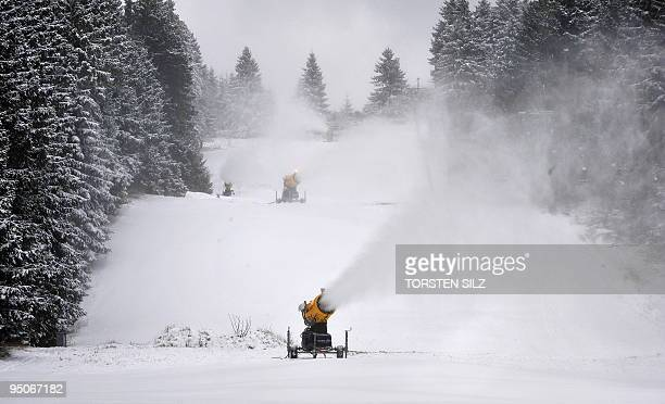 Snow cannons blow snow on a skiing track on December 15 2009 on the 818meterhigh Erbeskopf mountain near Thalfang western Germany where temperatures...