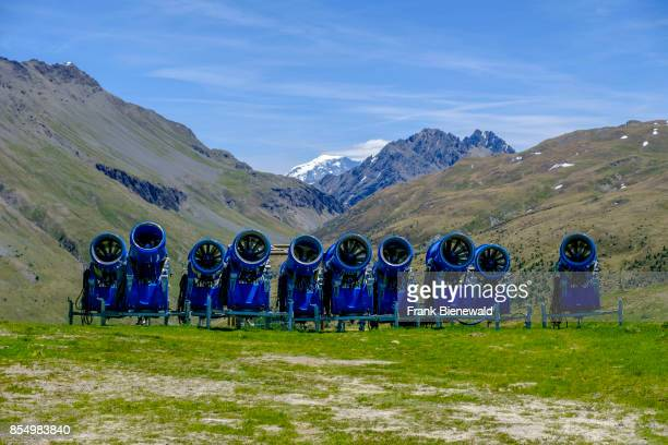 Snow cannons snow blowers are stored on a mountain slope during summer