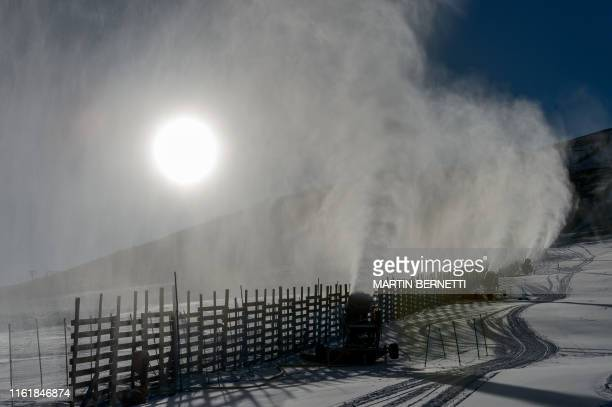 Snow cannons spray artifical snow on a ski slope at El Colorado skiing centre, in the Andes Mountains, some 30 km from Santiago on August 8, 2019. -...