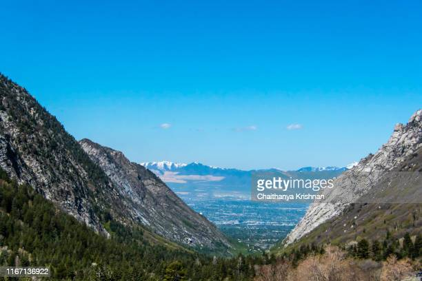 a snow capped mountain peak in wasatch mountain range close to salt lake city, ut - provo stock pictures, royalty-free photos & images