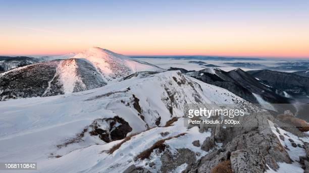 snow capped mountain range - peter snow stock pictures, royalty-free photos & images