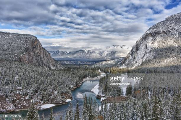 snow capped mountains and river in winter - dramatic landscape stock pictures, royalty-free photos & images