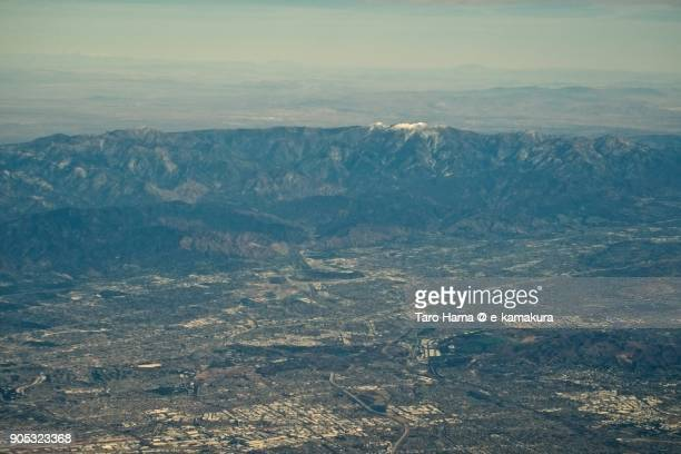 Snow capped mountains in Angeles National Forest in California in USA daytime aerial view from airplane