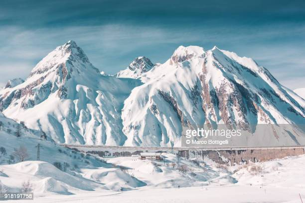 snow capped mountains in winter - mountain range stock pictures, royalty-free photos & images