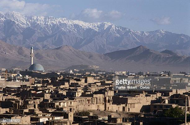 Snow capped mountains of the Hindu Kush range surround the Afghan capitol of Kabul.