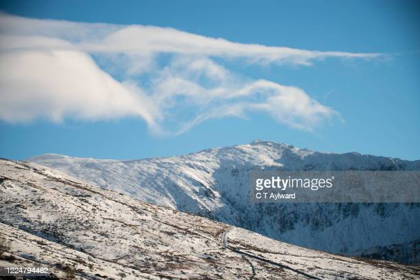 snow capped snowdon mountain range - snow stock pictures, royalty-free photos & images