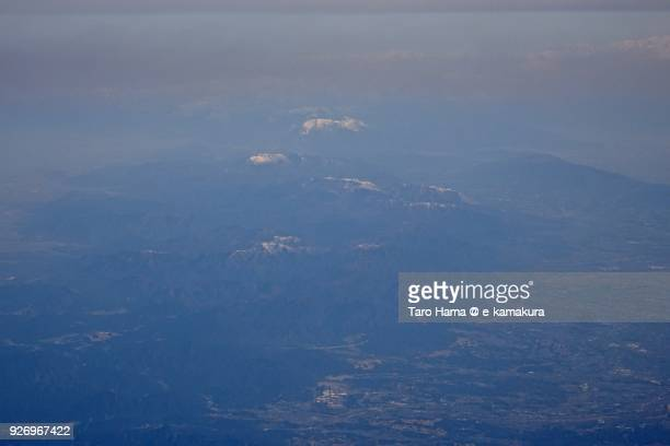 snow capped suzuka mountain range in mie prefecture in japan daytime aerial view from airplane - 三重県 ストックフォトと画像