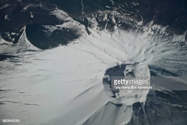 Snow capped top of Mt. Fuji daytime aerial view from airplane
