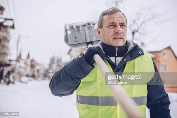 snow cleaning day - snow shovel stock photos and pictures