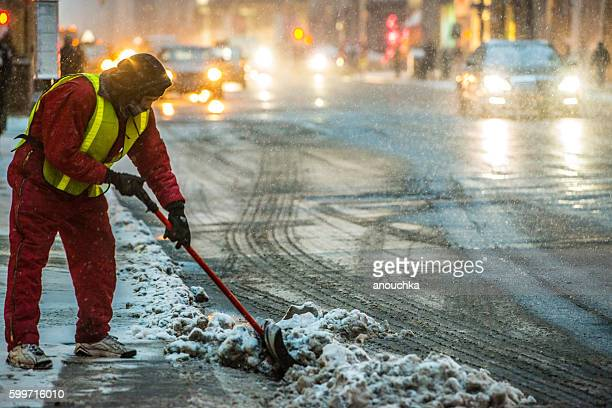 Snow cleaning during winter blizzard in New York, USA