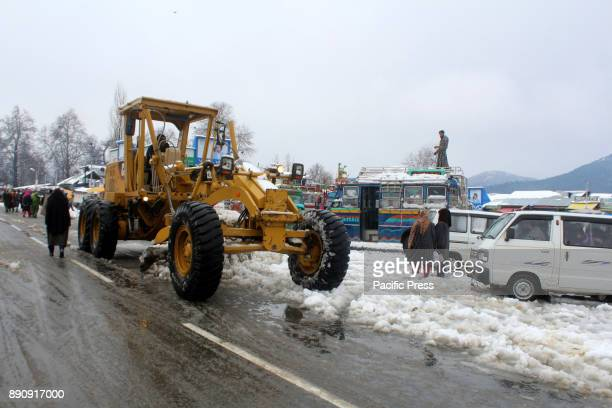 Snow clearance machines clearing snow on Roads closed SrinagarJammu highway on December 12 2017 in Lower Munda 85 km south of Srinagar the summer...