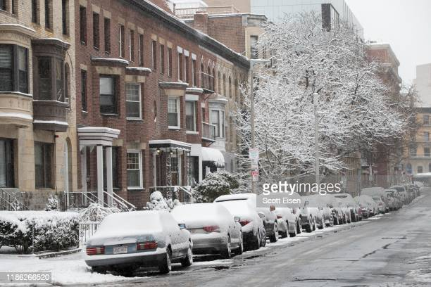 Snow coats cars parked on Hemenway Street as the first winter storm of the season impacts the region on December 3 2019 in Boston Massachusetts