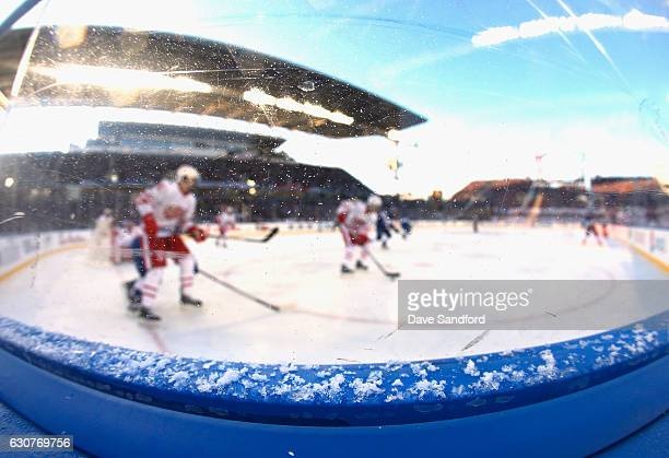Snow collects on the rim of the boards as the Detroit Red Wings play the Toronto Maple Leafs in the 2017 Scotiabank NHL Centennial Classic at...