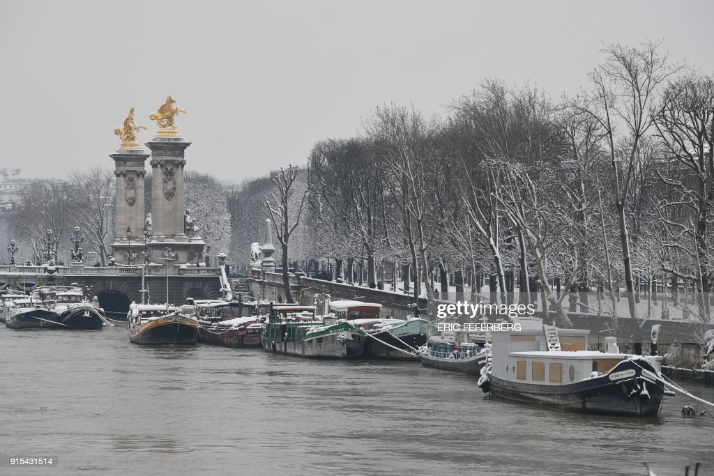 Snow Coverd Houseboats Are Moored On The Banks Of The River Seine