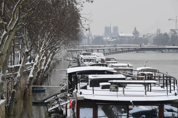 Snow Coverd Houseboats Are Moored On The Bbanks Of The River Seine