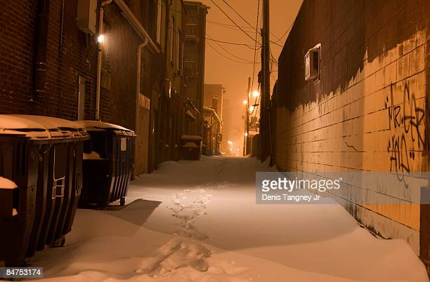 snow covered alleyway - chilly bin stock photos and pictures