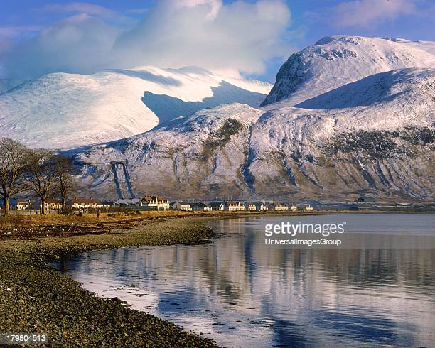 Snow covered Ben Nevis highest mountain in the British Isles from Coal Loch Linnhe Lochaber Scottish Highlands Scotland United Kingdom