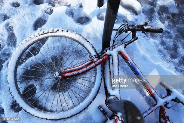 A snow covered bike sits on the street after yesterday's snow storm on January 4 2018 in Savannah Georgia From Maine to Florida every state along the...